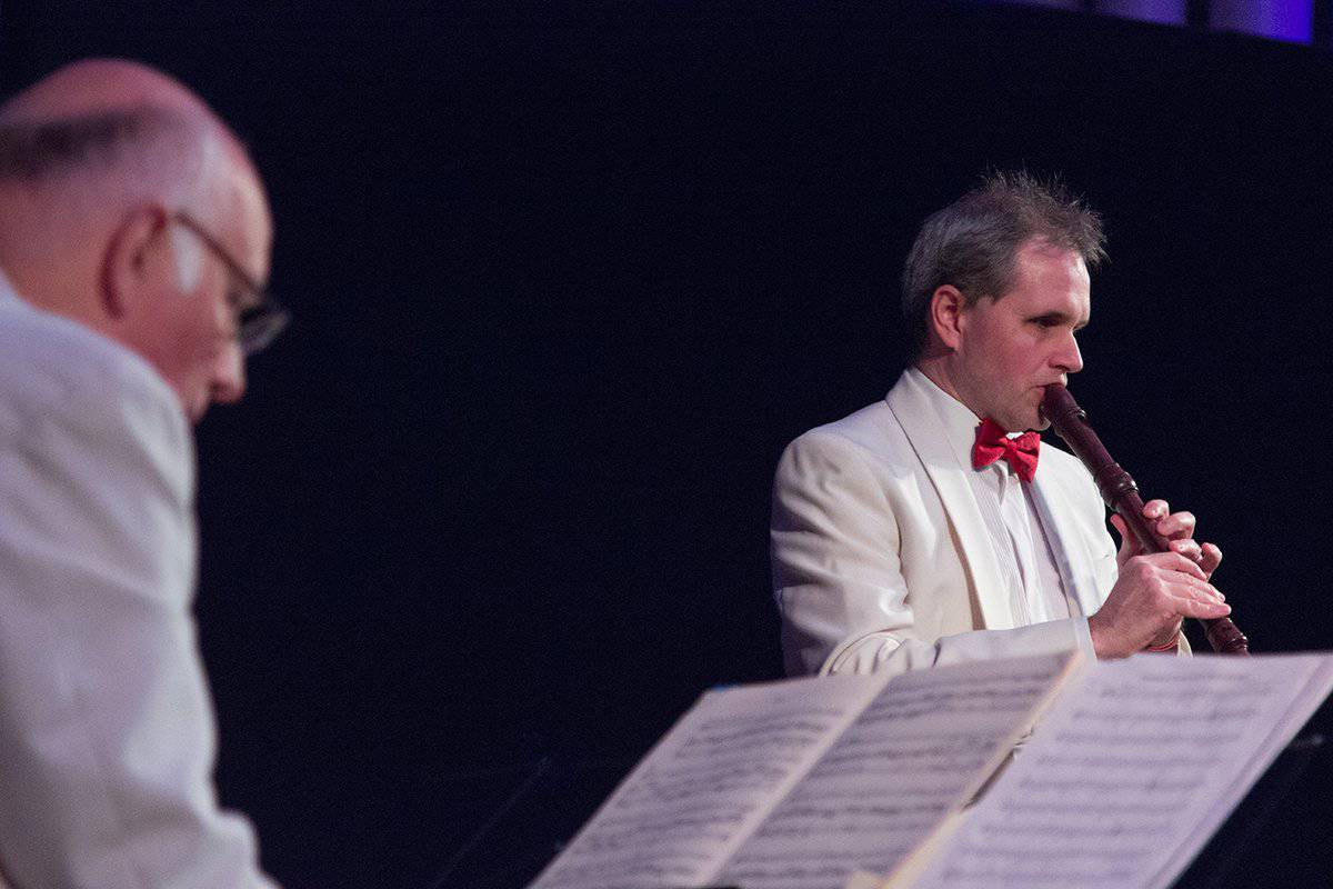 CRDN RAREfest18, blind musician James Risdon plays recorder in a white suit jacket with red bow tie accompanied by a keyboard player in matching outfit